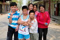 Group friendly children accompanied young mother pose main street wan jia village sichuan province china Royalty Free Stock Photos