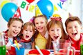 Group of friends adorable kids looking at camera at birthday party Stock Images