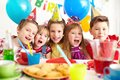 Group of friends adorable kids looking at camera at birthday party Stock Photography