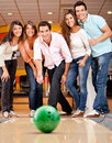 Group of friends bowling Stock Photo