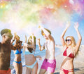 Group of friends dance under a color splash Royalty Free Stock Photo