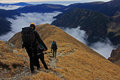 Group of friends descending of the mountain in romania Royalty Free Stock Photo