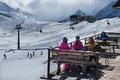 Two female friends enjoying hot drink In cafe at ski resort