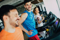 Group of friends exercising on treadmill machine Royalty Free Stock Photo