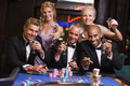 Group of friends gambling at roulette table Stock Image