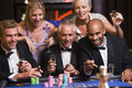 Group of friends gambling at roulette table Royalty Free Stock Photo
