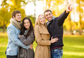 Group of friends having fun in autumn park summer holidays vacation happy people concept or couples Royalty Free Stock Image