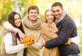 Group of friends having fun in autumn park summer holidays vacation happy people concept or couples Stock Image