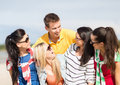 Group of friends having fun on the beach summer holidays vacation happy people concept Royalty Free Stock Image