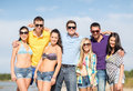 Group of friends having fun on the beach summer holidays vacation happy people concept Stock Photography