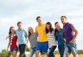Group of friends having fun on the beach summer holidays vacation happy people concept Royalty Free Stock Photos