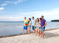 Group of friends having fun on the beach summer holidays vacation happy people concept Stock Photo
