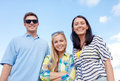 Group of friends having fun on the beach summer holidays vacation happy people concept Stock Photos