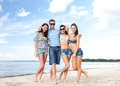 Group of friends having fun on the beach summer holidays vacation happy people concept Royalty Free Stock Images