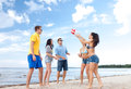 Group of friends having fun on the beach summer holidays vacation happy people concept Stock Image