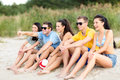 Group of friends having fun on the beach summer holidays vacation happy people concept or volleyball team Stock Photo