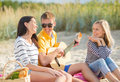 Group of friends having fun on the beach summer holidays vacation music happy people concept with guitar Royalty Free Stock Photos
