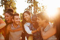 Group of friends having fun together outdoors smiling at each other Stock Photography