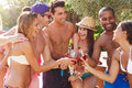 Group Of Friends Having Party By Swimming Pool Royalty Free Stock Photo