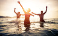 Group of friends jumping and make party in the water Royalty Free Stock Photo