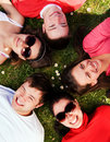 image photo : Group of friends lying on grass looking up