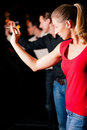 Group of friends playing darts Royalty Free Stock Image
