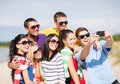 Group of friends taking picture with smartphone summer holidays vacation happy people concept Royalty Free Stock Photography