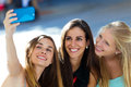Group of friends taking selfie in the street outdoor portrait Royalty Free Stock Photography