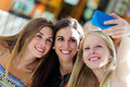 Group of friends taking selfie in the street outdoor portrait Royalty Free Stock Photo