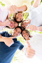 Group of friends with thumbs up happy outdoors Royalty Free Stock Images