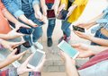 Group of friends using their smart mobile phones - Millennial young people addicted to new technology trends Royalty Free Stock Photo
