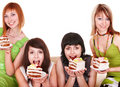 Group girl eating chocolate cake. Royalty Free Stock Photo