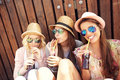 Group of girl friends drinking soda on the pier a picture a Stock Images