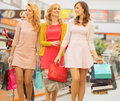 Group of girlfriends at the shopping cheerful Stock Images