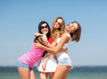 Group of girls chilling on the beach summer holidays and vacation having fun Stock Images