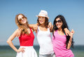 Group of girls chilling on the beach summer holidays and vacation having fun Royalty Free Stock Images