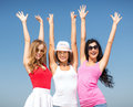 Group of girls chilling on the beach summer holidays and vacation having fun Royalty Free Stock Photography