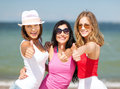 Group of girls chilling on the beach summer holidays and vacation showing thumbs up Stock Image