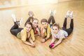 Group of girls in fitness class at the break laying floor Royalty Free Stock Photography