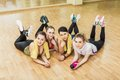 Group of girls in fitness class at the break laying floor Royalty Free Stock Image