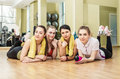 Group of girls in fitness class at the break laying floor Royalty Free Stock Photo