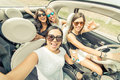 Group of girls having fun with the car Royalty Free Stock Photo