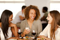 Group of girls laughing in a restaurant mixed race pizza Royalty Free Stock Image