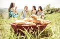 Group of girls making picnic in the weekend on hills concept about food friendship nature and people Royalty Free Stock Photos