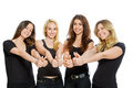 Group of girls standing with thumbs up isolated on white Royalty Free Stock Photography