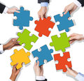 Group of Hands Holding Jigsaw Puzzle Royalty Free Stock Photo