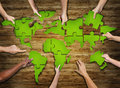 Group of Hands Holding Jigsaw Puzzle Forming World Royalty Free Stock Photo