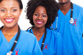 Group happy african healthcare workers red ribbon aids awareness Stock Images