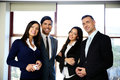 Group of happy business people standing in the office Royalty Free Stock Photo