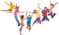 Group of happy cheerful sportive children jumping and dancing large isolated over white background childhood freedom happiness Stock Photos